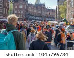 kings day crowds in amsterdam  | Shutterstock . vector #1045796734