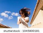 beautiful young woman making... | Shutterstock . vector #1045800181