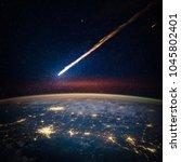 falling meteorite  asteroid ... | Shutterstock . vector #1045802401