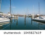 white yachts in the port are... | Shutterstock . vector #1045827619