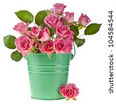Stock photo pink rose bouquet in a green bucket isolated on white background 104584544