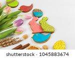 tulips and gingerbread cookies... | Shutterstock . vector #1045883674