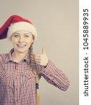 Small photo of Xmas, seasonal clothing, winter christmas concept. Happy woman wearing windblown Santa Claus helper hat