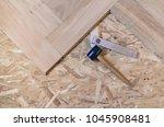 parquet floor renovation | Shutterstock . vector #1045908481