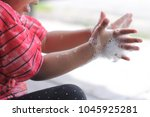 cute girl washing her hand and... | Shutterstock . vector #1045925281