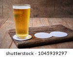 Beer In Glass On Old Wooden...