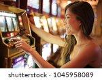 asian woman gambling in casino... | Shutterstock . vector #1045958089