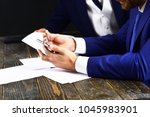 hands with smartphone on desk.... | Shutterstock . vector #1045983901