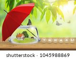 property insurance  toy house... | Shutterstock . vector #1045988869