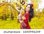 beautiful young woman wearing... | Shutterstock . vector #1045996249