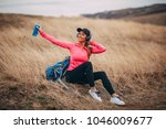 happy woman with backpack... | Shutterstock . vector #1046009677