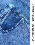 pocket and rivet on jeans.... | Shutterstock . vector #1046010394