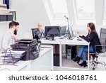 group of young people working... | Shutterstock . vector #1046018761