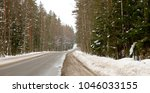 winter road covered with snow... | Shutterstock . vector #1046033155