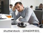 worried beard man looking at...   Shutterstock . vector #1046049301