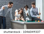 happy business people playing...   Shutterstock . vector #1046049337