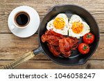 english breakfast   fried egg... | Shutterstock . vector #1046058247