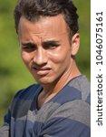 Small photo of Unhappy Hispanic Male