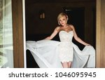 the girl is in a white dress.... | Shutterstock . vector #1046095945
