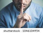 caucasian man making silence... | Shutterstock . vector #1046104954