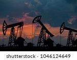 oil pumps on the sunset | Shutterstock . vector #1046124649