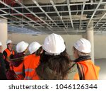 helmets and reflective vests as ... | Shutterstock . vector #1046126344