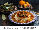 iranian sweet rice with orange...   Shutterstock . vector #1046127817