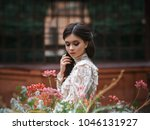 a girl walks in a flowering... | Shutterstock . vector #1046131927
