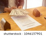 man is handing money to real... | Shutterstock . vector #1046157901
