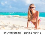 longhaired woman in bikini... | Shutterstock . vector #1046170441