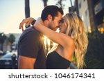 romantic couple kissing on...   Shutterstock . vector #1046174341