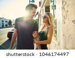 flirty romantic couple walking... | Shutterstock . vector #1046174497