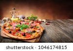 hot pizza served on old table | Shutterstock . vector #1046174815