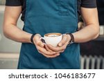 barista in black t shirt and... | Shutterstock . vector #1046183677