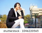 guy using a smart phone to... | Shutterstock . vector #1046220565