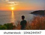 Man Looking To Sunset On Islan...