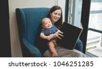 mother reading a book to her...   Shutterstock . vector #1046251285