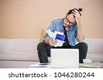 worried young man paying his... | Shutterstock . vector #1046280244