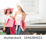 happy young women with shopping ... | Shutterstock . vector #1046284021