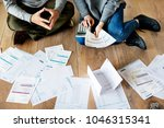 couple managing the debt | Shutterstock . vector #1046315341
