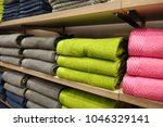 piles of towels on a shelves | Shutterstock . vector #1046329141