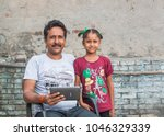 an unidentified person helps an ...   Shutterstock . vector #1046329339