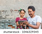 an unidentified person helps an ... | Shutterstock . vector #1046329345