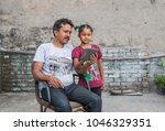 an unidentified person helps an ...   Shutterstock . vector #1046329351