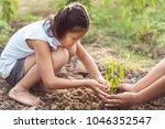 asian children planting small... | Shutterstock . vector #1046352547