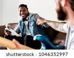 musicians fist bumping   Shutterstock . vector #1046352997