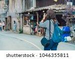 backside of asian traveler... | Shutterstock . vector #1046355811