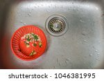 close up kitchen sink with food ... | Shutterstock . vector #1046381995