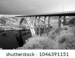 modern concrete road bridge... | Shutterstock . vector #1046391151