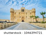 the alley with cannons leads to ...   Shutterstock . vector #1046394721
